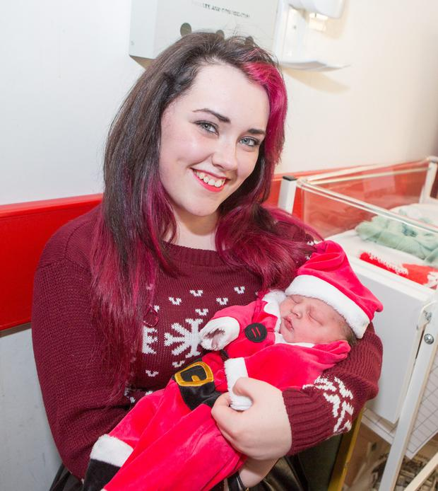 25/12/2015. Christmas Day baby Kian O'Connell is held by his sister jamie. Kian was born at 10.21am weighing in at 7lbs 1oz to mum Zara O'Regan and dad Jamie O'Connell, from Shannon. Photograph Liam Burke/Press 22