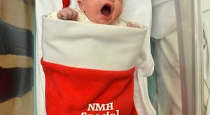 Daughter of Robert and Annmarie Mullervy from Arklow, Co. Wicklow, Elaina yawns after being the first baby born at the National Maternity Hospital in Holles Street, Dublin, Ireland on Christmas Day, Friday 25 December 2015. Elaina, who was born at 01:59 weighing 8 lb 8 oz (3.8kg), is the couple's first child. Photo credit: Barbara Lindberg.