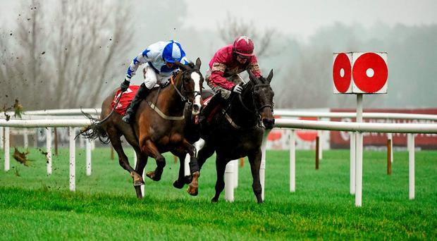 Apple's Jade, right, with Johnny Burke up, ahead of Jer's Girl, with Robbie Power up, on their way to winning the Knight Frank Juvenile Hurdle. Leopardstown Christmas Racing Festival, Leopardstown Racecourse, Dublin. Picture credit: Matt Browne / SPORTSFILE