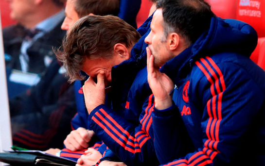 Manchester United manager Louis van Gaal sits dejected on the bench during his side's loss to Stoke City at the Britannia Stadium, Stoke. PRESS ASSOCIATION
