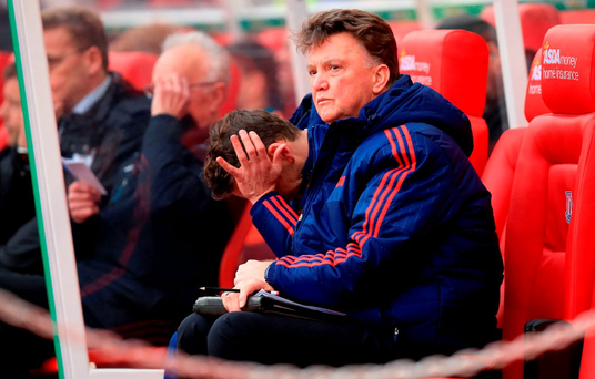 Manchester United manager Louis van Gaal sits dejected during his side' thrid consecutive Premier League loss against Stoke City at the Britannia Stadium. PRESS ASSOCIATION