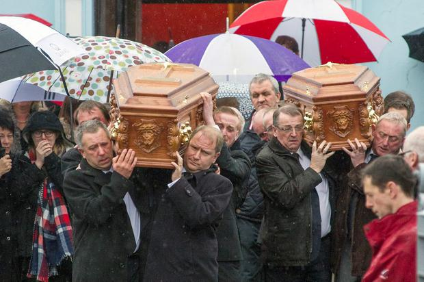 Noel Clancy (front left) carries the remains of daughter and mother Louise and Geraldine Clancy pictured at St. Martin's Church, Kilworth.