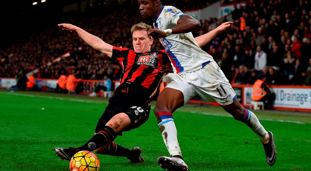 AFC Bournemouth's Matt Ritchie (left) tackles Crystal Palace's Wilfried Zaha. PRESS ASSOCIATION.