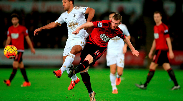 West Bromwich Albion's Chris Brunt battles to get ball away under challenge from Swansea City's Wayne Routledge at the Liberty Stadium, Swansea. PRESS ASSOCIATION Photo.