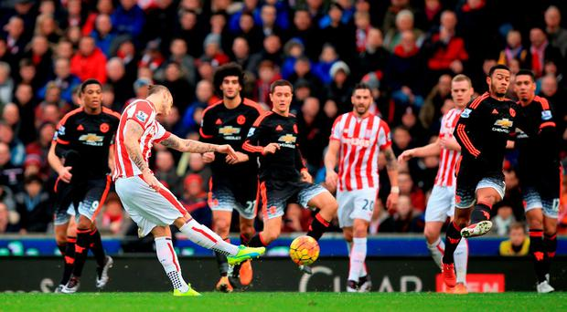 Marko Arnautovic scores Stoke's second goal in the win over Manchester United at the Britannia Stadium yesterday. Photo: Mike Egertonhis