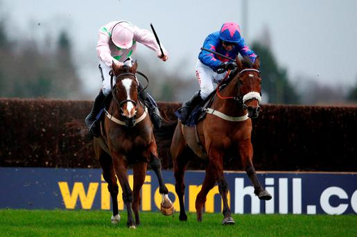 Paddy Brennan on Cue Card (r) alongside Vautour and Ruby Walsh after clearing the last on the way to winning the King George at Kempton yesterday. Photo: Alan Crowhurst/Getty Images