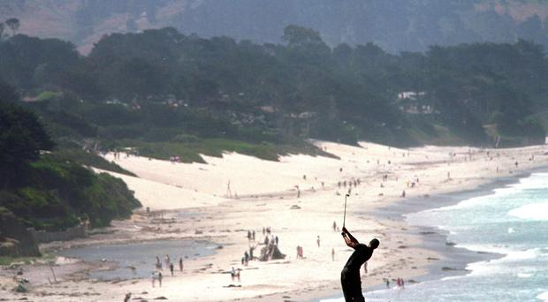 15 Jun 2000: Tiger Woods takes a swing during the 100th U.S. Open at the Pebble Beach Golf Club in Pebble Beach, California.Mandatory Credit: Jamie Squire /Allsport