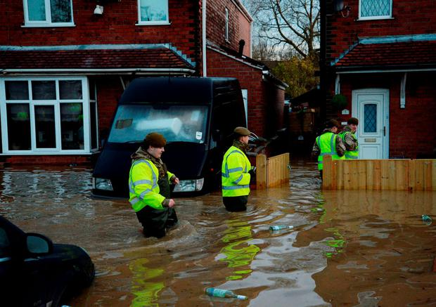 Soldiers check on residents and their properties in York, after the River Foss bursts its banks. Anna Gowthorpe/PA Wire