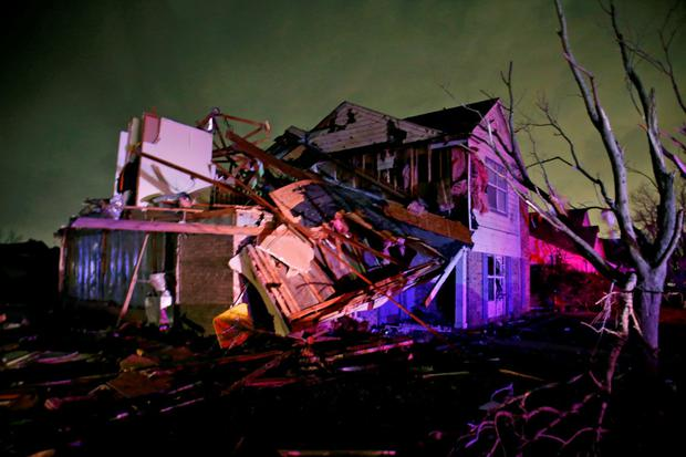 Debris lies on the ground near a home that was heavily damaged by a tornado in Rowlett, Texas, Saturday, Dec. 26, 2015. Tornadoes swept through the Dallas area after dark on Saturday evening causing significant damage. (Guy Reynolds/The Dallas Morning News via AP) MANDATORY CREDIT; MAGS OUT; TV OUT; INTERNET USE BY AP MEMBERS ONLY; NO SALES