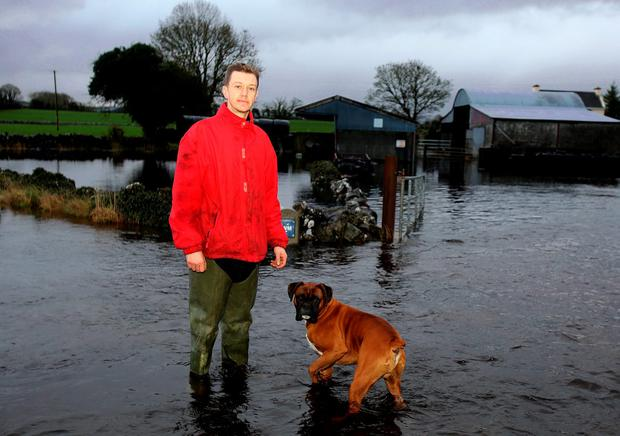 Wet Christmas for Padric Collins and his family from Skehana, Co. Galway how were stranded at their homes over Christmas surrounded by flood water. Picture: Hany Marzouk