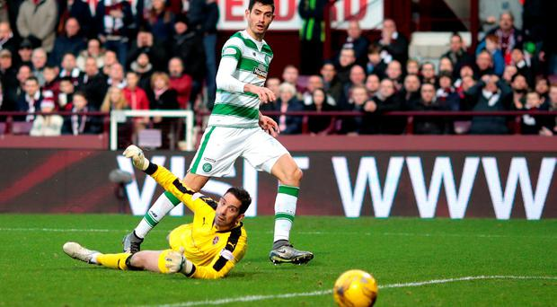 Celtic's Nir Bitton scores their first goal in their draw against Hearts at Tynecastle Photo: Reuters / Graham Stuart