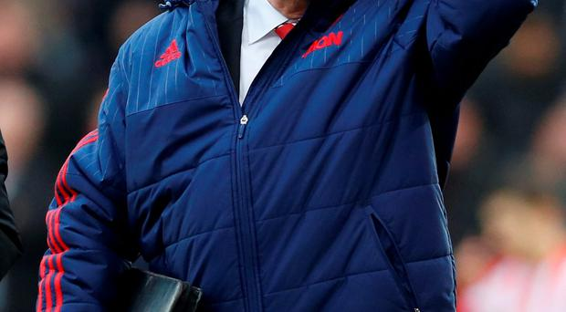 Man Utd manager Louis van Gaal is under intense pressure as he leads his team into their encounter with Chelsea Photo: Reuters / Carl Recine