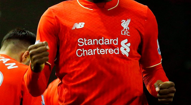 Christian Benteke celebrates after scoring the winning goal for Liverpool against Leicester Photo: LINDSEY PARNABY / AFP / Getty Images