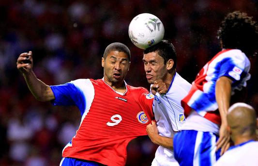 Costa Rica's Alvaro Saborio (L) fights for the ball with El Salvador's Alfredo Pacheco during their 2014 World Cup qualifying soccer match at the national stadium in San Jose REUTERS/Juan Carlos Ulate/Files