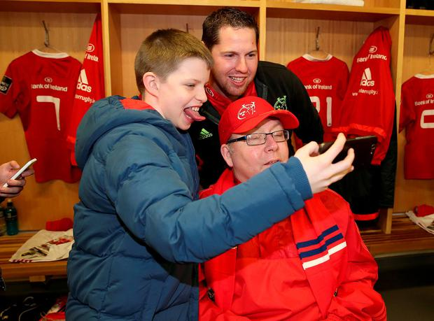 Lifelong Munster Rugby supporter Thomas Kellegher pictured with his family and friends in Thomond Park Credit: ©INPHO/Dan Sheridan