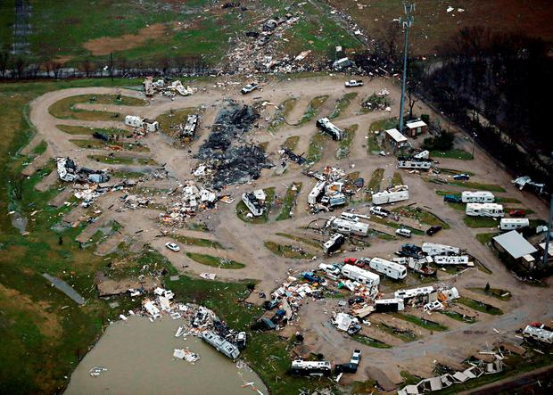 Damage is seen in a mobile home park after Saturday's tornado in Garland, Texas, Sunday Credit: G.J. McCarthy/The Dallas Morning News (AP)