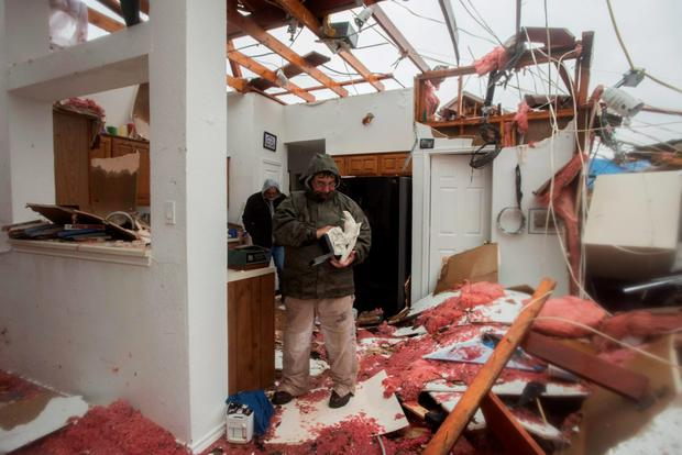 Bob Moore stands in his house in Rowlett, Texas, the morning after it was damaged by a tornado Credit: Rex C. Curry (AP)