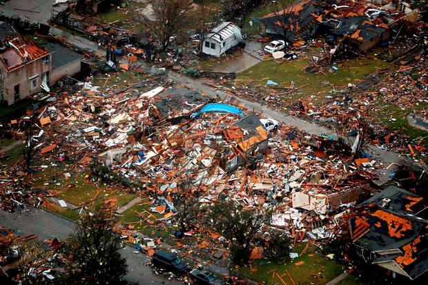 Damage of home buildings seen after Saturday's tornado in Garland, Texas Credit: G.J. McCarthy/The Dallas Morning News (AP)