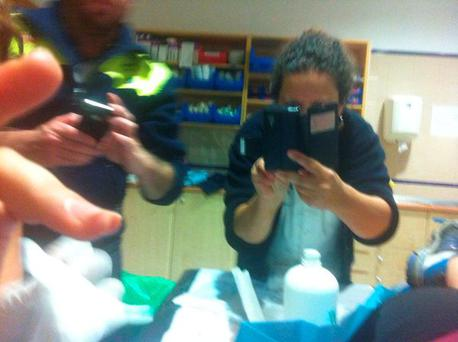 Cristina Ojeda-Thies as she was treated by doctors after the attack Credit: @ojedathies (Twitter)