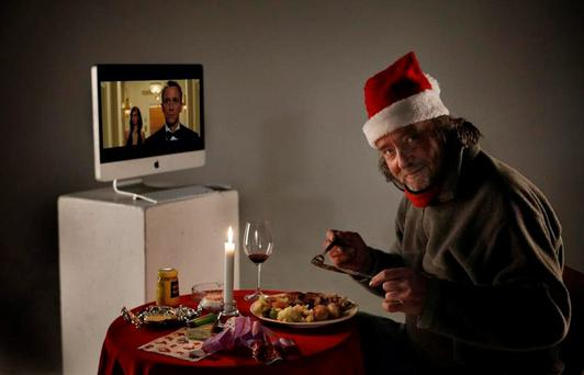 Martin enjoying Christmas dinner in front of the television Credit: Donal Moloney