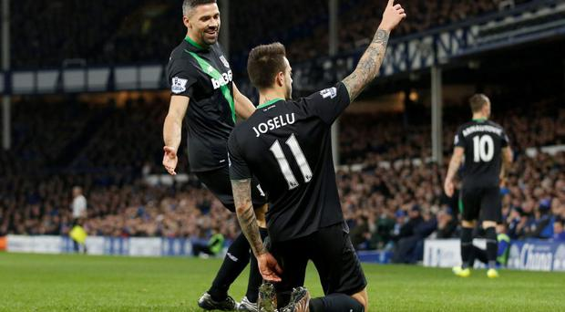Stoke's Joselu celebrates scoring their third goal with Jonathan Walters