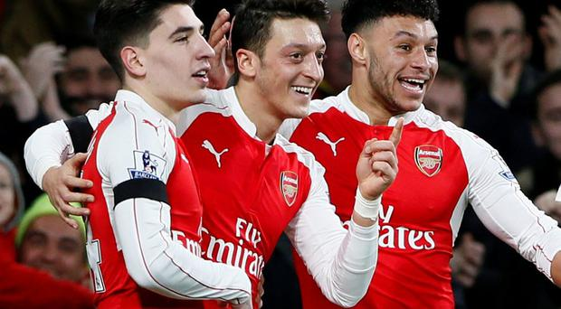 Arsenal's Mesut Ozil celebrates scoring their second goal with Hector Bellerin and Alex Oxlade Chamberlain