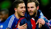 Manchester United's Juan Mata with Chelsea's Eden Hazard after the game