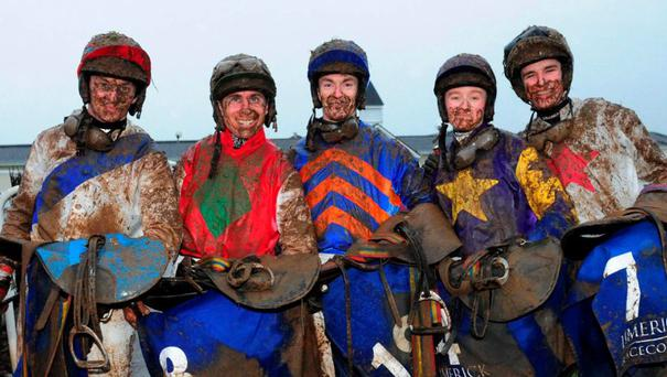 Mark Bolger, Philip Enright, Andrew Ring, Jane Mangan and Danny Mullins make light of the dreadful conditions after riding in the Parkway Shopping Centre Handicap Hurdle at Limerick yesterday.