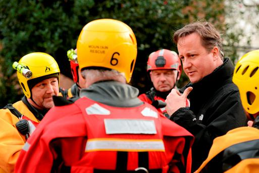 David Cameron meeting Mountain Rescue at the edge of the floods in York, as swamped towns and cities continue to struggle against the Christmas floods. Photo: SSgt Mark Nesbit RLC (Phot)/MoD Crown Copyright/PA Wire