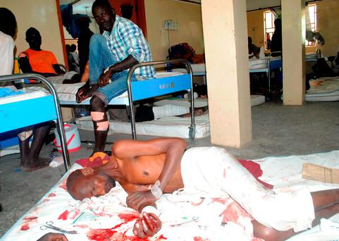 Victims of a Boko Haram attack receive treatment at a hospital in Maiduguri, Nigeria, yesterday. AP Photo/Jossy Ola