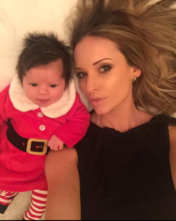 Becky Gibson with her newborn daughter