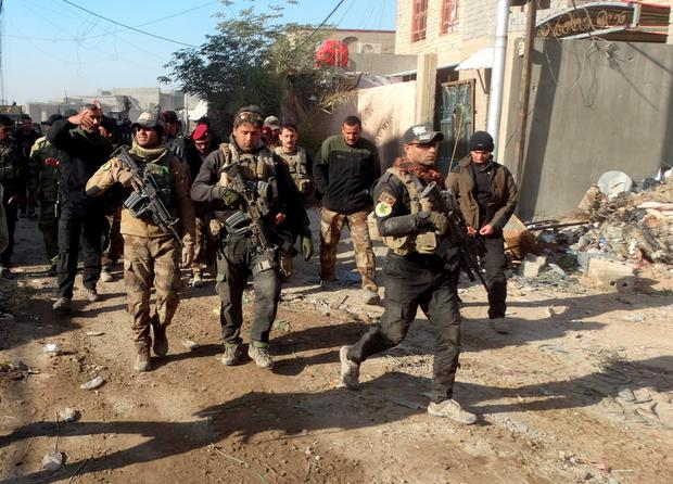 Iraqi military forces on Monday retook a strategic government complex in the city of Ramadi from Islamic State militants who have occupied the city since May Credit: Osama Sami (AP)