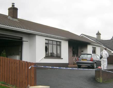 Police and forensics staff at the scene after an elderly woman died in a house fire at Silverhill Park in Enniskillen, Co Fermanagh