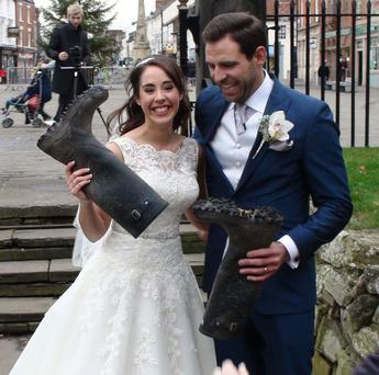 Lucy and Peter Nickson who wore wellington boots to their wedding ceremony Credit: PA Wire