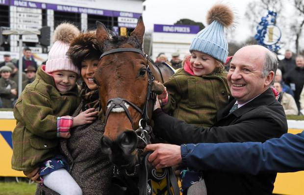 Owners Andrea and Graham Wylie, with their daughters , Zhara, left, and Kiera celebrate with Nichols Canyon after winning the Ryanair Hurdle. L