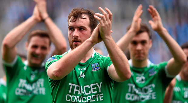 Sean Quigley leads his Fermanagh team-mates as they acknowledge their supporters after their Championship defeat to Dublin (Photo: Sportsfile)