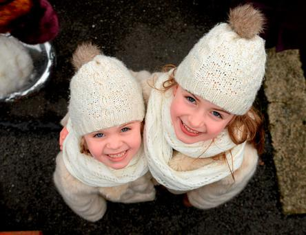 Sisters Éabha Devitt, age, 5, and Muireann, age 7, at the Leopardstown Christmas Racing Festival. Picture credit: Cody Glenn / SPORTSFILE