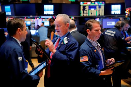 Traders work on the floor of the New York Stock Exchange shortly after the opening bell in New York December 29, 2015. Photo: Reuters