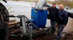 Gerry Naughton and Shane Nolan (on right) with the water pump. Photograph: Hany Marzouk