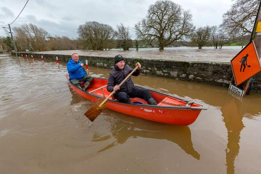 Shem Caulfield and John Kedney paddle along the quay after the Nore burst its banks at Thomastown, Co Kilkenny. Picture Dylan Vaughan.