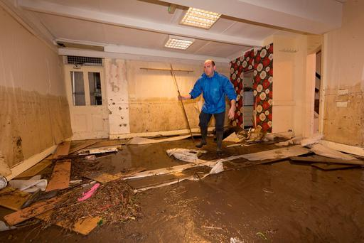 Wayne Holden cleans up the damage on in a premises Lower Main Street in Graiguenamanagh Co. Kilkenny Picture Dylan Vaughan.