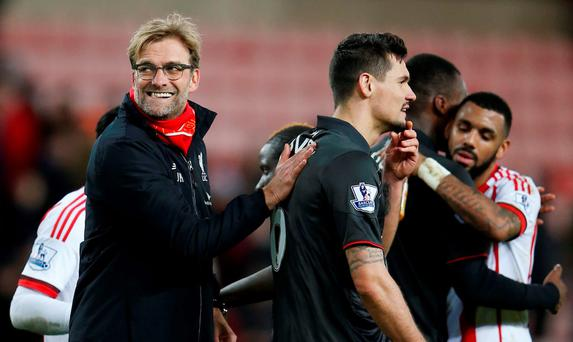 Liverpool manager Juergen Klopp celebrates with Dejan Lovren after the game