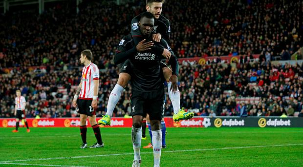 Christian Benteke celebrates scoring the winner with teammate Adam Lallana. Reuters / Andrew Yates