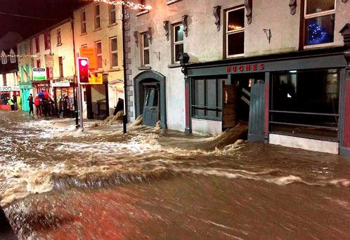 Floodwaters burst through the doors of buildings in Graiguenamanagh, Co Kilkenny