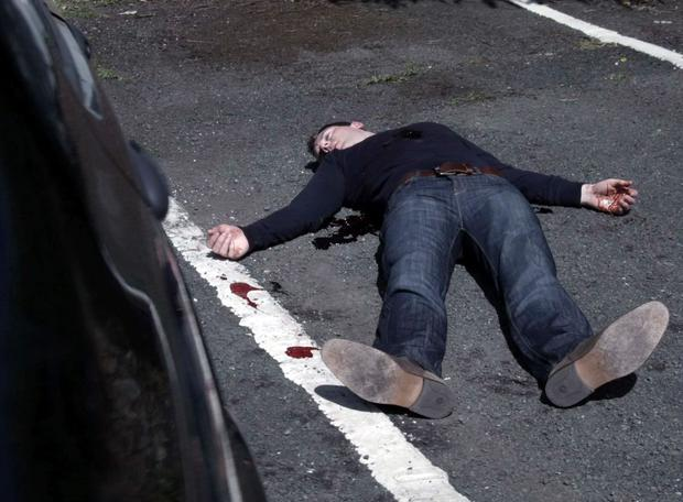 Garda Superintendent James McKay lies dead outside the Red Rock Garda Station.
