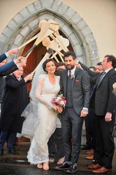 New Year's Eve Bliss forToday FM Presenter Louise Duffy and Kerry Footballer Paul Galvin as they leave St Tiernan's Church Crossmolina Mayo where they were married yestersday. Pic Conor McKeown