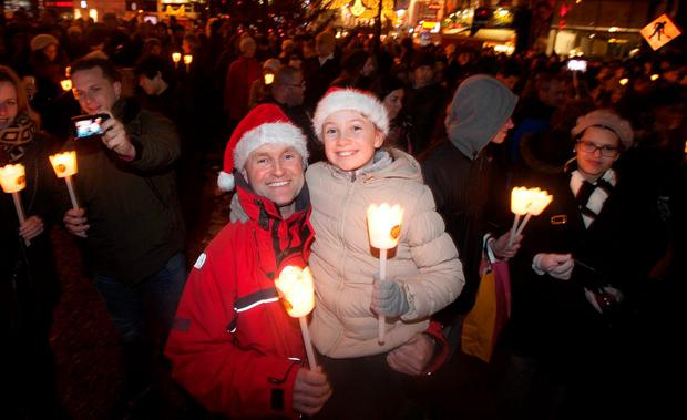 Ciara Bowen (10) and Paul Bowen both from Inchicore at the Procession of Light ceremony in Dublin's City Centre as part of the NYF Dublin festival