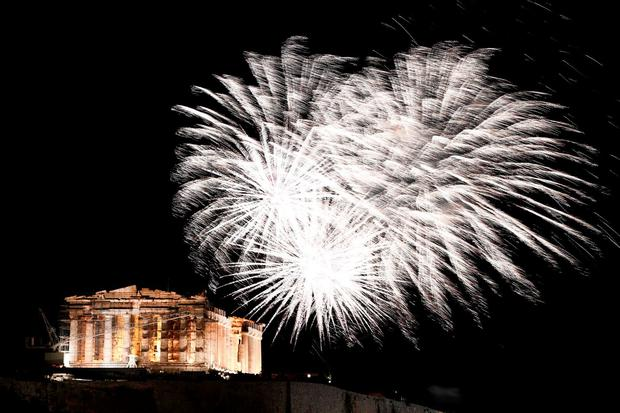 Fireworks explode above the ancient temple of Parthenon atop the Acropolis hill during the New Year celebrations in Athens on January 1, 2016. / AFP / ANGELOS TZORTZINISANGELOS TZORTZINIS/AFP/Getty Images