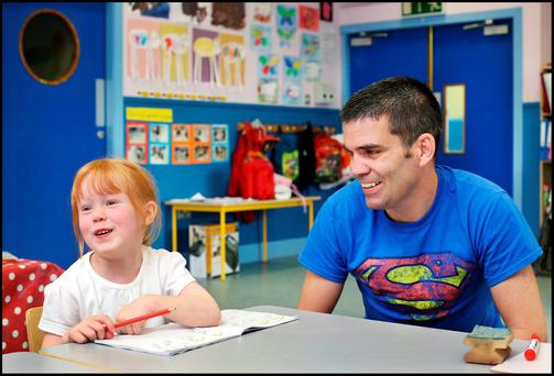 Bernard Dunne at the opening of Gaelscoil na Giuise at Firhouse Community Centre with student Alex Ni Cheallaigh. Photo: Steve Humphreys