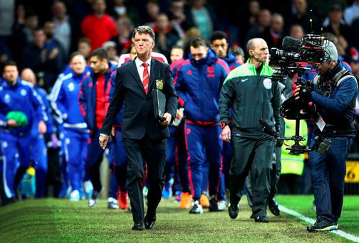 Louis van Gaal, manager of Manchester United walks to the bench